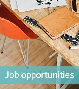 job opportunities and openings at the bridal flower, photo of a desk, orange chair, notebook and ruler
