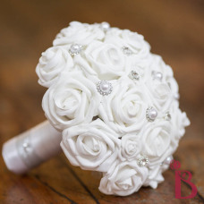 white and silver wedding bouquet with brooch gems pearls