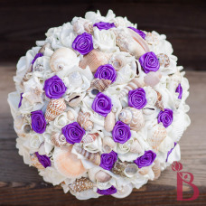 top view of seashell bouquet with purple rosettes in royal purple