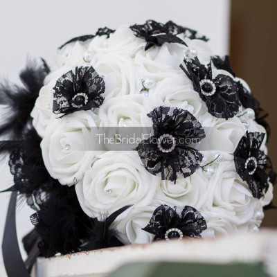 black and white wedding bouquet with pearls and feathers