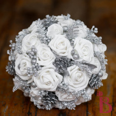 silver and white winter bouquet with silver glitter pine cones and berries