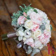 ivory and pastel pink wedding bouquet with peonies and anemones and dusty miller leaves