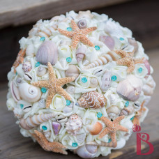 top view of tiffany blue seashell bouquet with shells and star fish large beach weddings