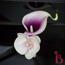 real feel purple calla boutonniere white edges orchid with lavender middle