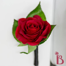 red rose boutonniere black ribbon leaves