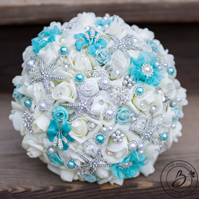 Luxurious aqua teal brooch bouquet with jewels and starfish – The ...
