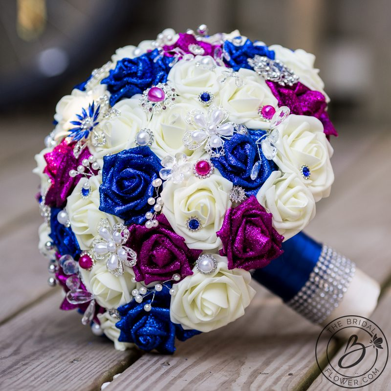 Royal blue and fuchsia pink jeweled wedding bouquet the bridal large wedding bouquet with glitter roses and a ton of brooches jewels and sparkly accents royal blue and fuchsia pink glitter roses among the ivory roses mightylinksfo