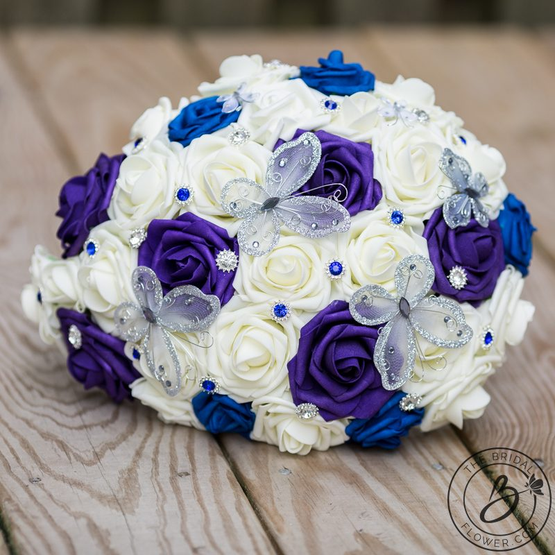 Blue and purple cascading bouquet with butterflies – The Bridal ...