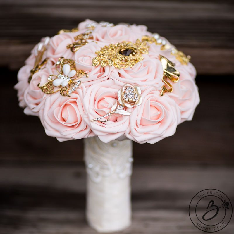 Blush pink and gold brooch wedding bouquet with lace the bridal blush pink and gold brooch bouquet with blush pink soft touch roses accented with gold brooches throughout handle covered in lace and pearl pins mightylinksfo